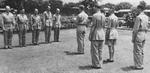 Colonel William E. Bergen reading medal citations while Lieutenant General Joseph Stilwell and Major General F. C. Sibert looked on, India, mid-1942