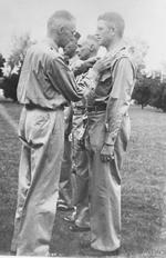 Lieutenant General Joseph Stilwell awarding the Purple Heart medal to Lieutenant Colonel Frank Merrill, India, 1942
