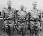 Lieutenant Colonel Frank Dorn (Silver Star), Colonel Robert P. Williams (Purple Heart), and Lieutenant Colonel Frank Merrill (Purple Heart) having just been awarded medals, India, mid-1942