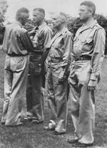 Lieutenant General Joseph Stilwell awarding the Silver Star medal to Lieutenant Colonel Frank Dorn, India, 1942