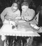Major General Liao Yaoxiang and Lieutenant General Joseph Stillwell studying a map, Burma, Mar 1944