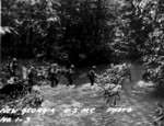 US Marines wading across a stream, New Georgia, 1943