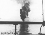 Smoke rising from a crashed Japanese aircraft, off Guadalcanal, late 1942; photo taken from transport Crescent City