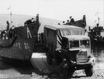 Bedford QL truck being loaded onto a LCT large landing craft during a training exercise, circa 1942, location unknown.