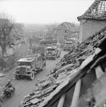 British convoy with CMP trucks passing the bombed out St. Laurentius church in Uedem, Germany, 2 Mar 1945. Note the long wheel-base CMP followed by a short wheel-base CMP.
