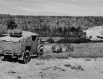 Gun crew using the onboard winch in their Canadian Chevrolet CMP 8440CGT Field Artillery Tractor to pull their QF 25-pounder howitzer up a hill, date and location unknown.