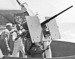 African-American mess attendants take their turn at a 20mm gun during gunnery training on Aircraft Transport USS Copahee during transit from California to Pearl Harbor, 9 Sep 1942. Note TBF Avengers on the flight deck.