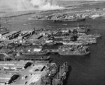 Aerial view of the Pearl Harbor repair basin with Ford Island beyond, Pearl Harbor, US Territory of Hawaii, 16 to 23 Jan 1946