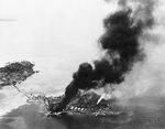 Japanese facilities afire, Tanambogo Island, east of Tulagi, Solomon Islands, 7 Aug 1942