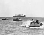 US Marine Corps LVT(1) amphibian tractors moving toward Guadalcanal, Solomon Islands, 7-9 Aug 1942; note USS President Hayes in background