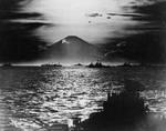 US and British warships in Sagami Bay, Japan, 27 Aug 1945; note Mount Fuji with setting sun behind it in background; photo taken from USS South Dakota