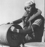 United States Coast Guard sailor setting the depth fuse on a depth charge aboard sub-Chaser PC-556 in the Atlantic, 8 Oct 1942
