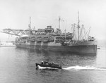 Troop transport USS Susan B. Anthony (converted luxury liner) in Mers-el-Kebir, Oran, Algeria preparing for the invasion of Sicily, 5 Jul 1943. Note LCVP landing craft hanging from her davits and stowed on her foredeck.