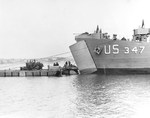 A Rhino barge docked with LST-347 in Portland Harbor, Dorset, England, United Kingdom during preparations for the Normandy invasion, 1 Jun 1944.
