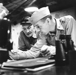 Carrier Task Force Commander Vice Admiral John McCain and Operations Officer Commander John Thach (fighter Ace) going over operational plans aboard USS Hancock during the Philippine campaign, Nov 1944 to Jan 1945.