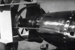 A still image taken from a US Navy training film showing the tail ring modification to the Mark XIII torpedo with a sailor holding a break-away wooden tail shroud that will go around it, 1945.