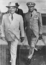 "US President Harry Truman and Pacific Fleet Commander Admiral Arthur Radford walking to their car at the Wake Island conference, 16 Oct 1950. Note lines from early wirephoto transmission ""noise."""