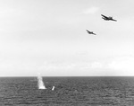 TBF-1 Avengers from the Carrier USS Essex dropping a practice torpedo from 150-200 feet, Gulf of Paria, Trinidad, 30 Mar 1943.  Note the porpoising early Mark XIII torpedo.