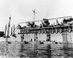 During rehearsals for the New Georgia operation, troops climb down nets hung over the side of attack transport USS McCawley to board LCVP landing craft at Noumea, New Caledonia, 14 Jun 1943