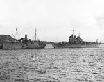 Cruiser USS St. Louis coming alongside repair ship USS Vestal at Espiritu Santo, New Hebrides for initial repair of torpedo damage to her bow received in the Battle of Kolombangara, 16 Jul 1943