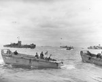 LCVP landing craft from LST-284 off Utah Beach, Normandy, France, 6 Jun 1944. LCI(L)-321 is in the background.