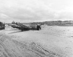 Razorback P-47D Thunderbolt of the 373rd Fighter Group after skidding to a stop on the sand of a Normandy beach, France, 14 Jun 1944.