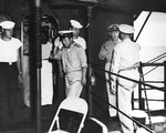 Imperial Japanese Navy Captain Masanori Shiga (saluting) boarding USS Levy for the surrender signing at Mili Atoll, 22 Aug 1945. US Navy area commander Captain HB Grow stands behind Shiga.