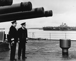 United States Navy Rear Admiral Robert Giffen (left) and Royal Navy Vice-Admiral Alban Curteis aboard HMS Duke of York at Scapa Flow, Scotland, United Kingdom, 5 Apr 1942. Note carrier USS Wasp (Wasp-class).