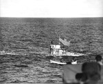 Captured German submarine U-505 three days after her capture as her tow was being transferred from the carrier USS Guadalcanal to the ocean-going tug USS Abnaki in the western Atlantic, 7 Jun 1944.