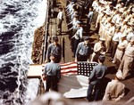 Burial at sea for a casualty of the battle for Iwo Jima aboard troop transport USS Hansford while she was evacuating wounded men to Saipan, 25-28 February 1945.