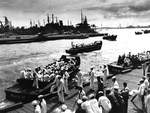 Liberty parties returning from Honolulu board LCVPs in Pearl Harbor to return to their ships, 9 May 1945. The LCVPs are from attack transports USS Hyde, USS Colusa, and USS Effingham.