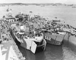 USS LST-646 and USS LST-662 entering the floating drydock USS ABSD-6 in Apra Harbor, Guam, 29 May 1945.
