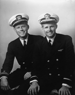 United States Navy Lieutenant (junior grade) John F. Kennedy (left) posing with his older brother Ensign Joseph P. Kennedy, Jr. on the United States east coast, May 1942.