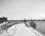 The submarine USS Nautilus approaching the pier at the submarine base in Pearl Harbor, Hawaii, 25 Aug 1942.
