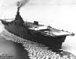 On the day of her commissioning, USS Lexington (Essex-class) makes slow headway through the icy waters of Boston harbor, Boston, Massachusetts, United States, 17 Feb 1943.
