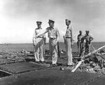 USS Randolph Captain Felix Baker (pointing) showing Admiral Raymond Spruance damage to the flight deck after a P1Y Ginga special attack bomber crashed into the ship at Ulithi, Caroline Islands, 11 Mar 1945.