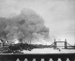 "Smoke rising from the Surrey Docks, London, England, United Kingdom, 8 Sep 1940, the morning after the opening night of ""The Blitz"" bombings as seen from London Bridge. Note Tower Bridge silhouetted against the smoke."