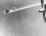 H8K flying boat in the midst of being shot down by the US Navy PB4Y-1 Liberator aircraft of Patrol Squadron VP-115 from which this photograph was taken, 2 Jul 1944. Photo 2 of 2.