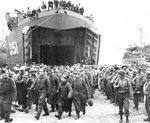 German prisoners-of-war captured at Anzio are offloaded from LST-351 at Naples, Italy in early 1944.