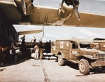 Air evacuation of wounded men from the Philippines on a mid-Pacific stop over, mid-1945. The wounded men are transferred from a PB2Y-3 Coronado to WC54 ambulances before boarding another plane bound for the US.
