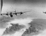 B-24 Liberator bombers of the 451st Bomb Group flying from Italy over Ploesti oil fields, Romania, May-Aug 1944. Photo 2 of 2.
