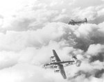A B-17G Fortress with the 96th Bomb Squadron joining up with a formation of B-24 Liberators from the 451st Bomb Group over Italy, 1944. The Liberator is a B-24L with the 724th Bomb Squadron.