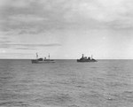 Cruiser USS Omaha (right) laying off the seized German blockade runner Odenwald in the South Atlantic, 6 Nov 1941. The Odenwald had been disguised as the US-flag ship Willmoto carrying rubber from Japan to Germany.
