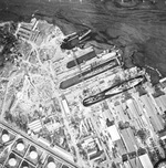 Aerial view of the drydocks at Pearl Harbor, Oahu, US Territory of Hawaii, 10 Dec 1941; note oil streaks. Pennsylvania is in Drydock #1 with Cassin and Downes and Helena is in Drydock #2. Photo 2 of 2.