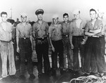 USS Pillsbury crew members who were the first party to board the German submarine U-505 after being abandoned by her crew, eastern Atlantic, 4 Jun 1944.