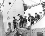 US Coast Guard Captain AC Richard disembarking USS Augusta during a tour of the beachhead by senior officers, 14 Jun 1944, off Omaha Beach, Normandy, France.