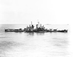 Cruiser USS Houston under tow by the USS Pawnee 17 Oct 1944 following Houston being torpedoed twice off Formosa (Taiwan) three days earlier. Note that Houston's draft is 6-feet deeper than the maximum to be seaworthy.