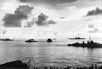 A destroyer escort dropping depth charges on a second Japanese Kaiten in the cruiser anchorage of Ulithi Lagoon on 20 Nov 1944 after the sinking of USS Mississinewa. Seen from USS Bunker Hill. Photo 2 of 3.