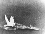 Japanese light cruiser Isuzu hit by an aerial Mark XIII torpedo dropped from a TBF-1 Avenger flown by Lt(jg) E.F. Ternasky flying from USS Lexington (Essex-class), Kwajalein, Marshall Islands, 4 Dec 1943