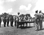 Lt General Toshiro Nomi signing the formal surrender all Japanese forces in the Ryukyu Islands to US Lt General Joseph Stillwell at US 10th Army headquarters, Yontan, Okinawa, Japan, 7 Sep 1945